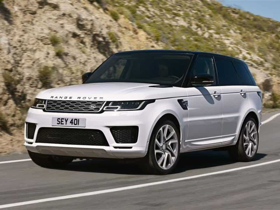 Range Rover Sport driving next to a hill
