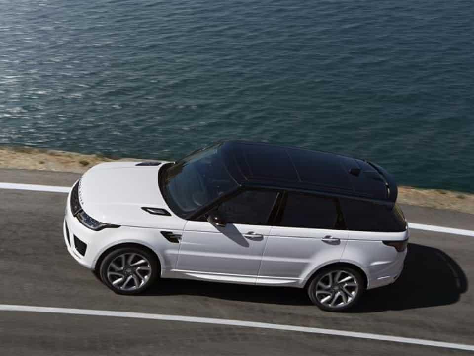 Range Rover Sport next to ocean