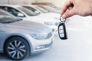man holding new lease car keys