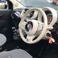 close up of a white fiat steering wheel